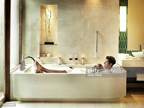Couple Together In A Luxury Bath Tub