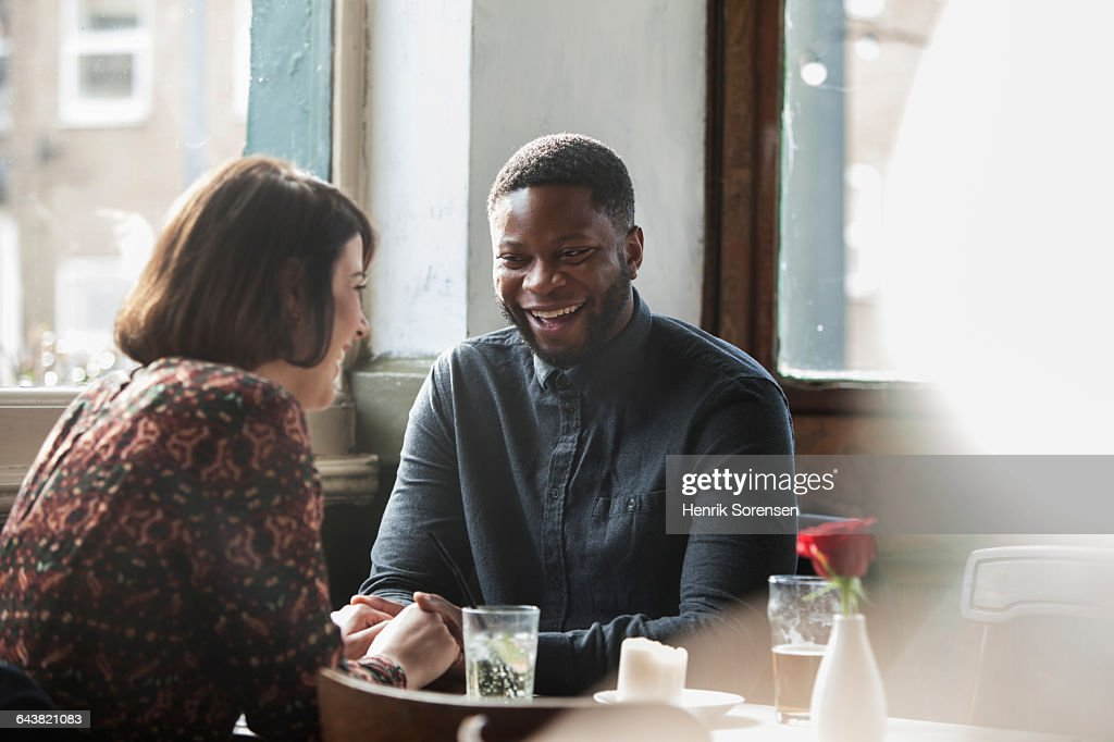 A couple together in a pub : Stock Photo