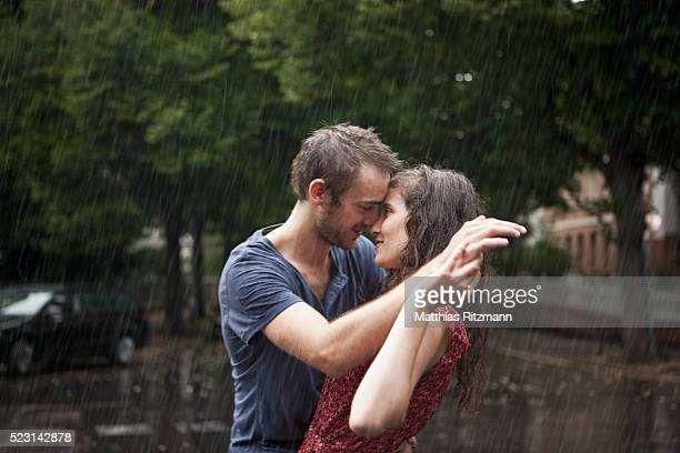 couple together in rain - romantic rainy day stock photos and pictures
