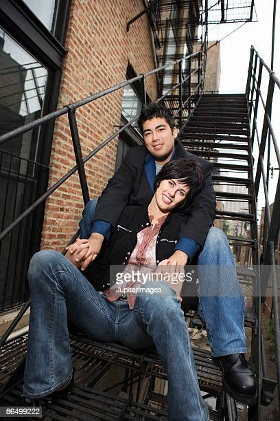 Couple together on fire escape