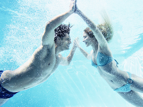 Couple touching hands underwater - gettyimageskorea