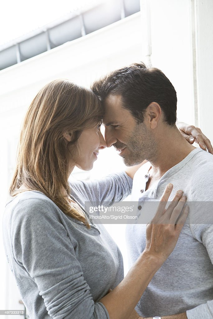 Mature couples rubbing