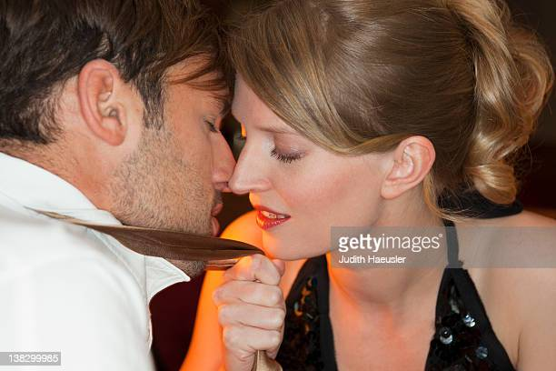 Couple touching noses in restaurant