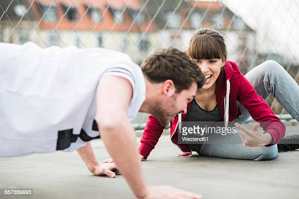 Couple training push ups