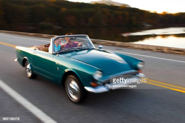 couple traveing - vintage car stock pictures, royalty-free photos & images