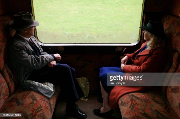 A couple travel to Pickering by steam train during the North Yorkshire Moors Railway 1940's Wartime Weekend event on October 14 2018 in Pickering...