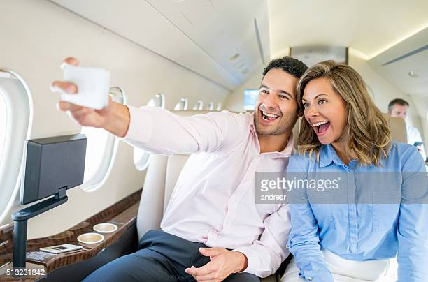 Couple traveling and taking a selfie in the airplane