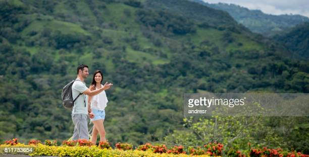 Couple traveling and walking at their beautiful hotel in the countryside
