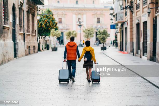 couple traveling around the world - arrival photos stock photos and pictures