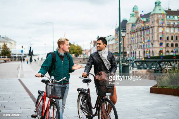 lgbt couple traveling around together - latino and scandinavian gay men enjoying their common life together - malmo stock pictures, royalty-free photos & images