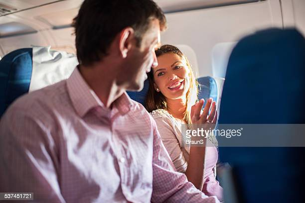 Couple traveling by airplane.