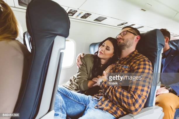 couple traveling by airplane - izusek stock pictures, royalty-free photos & images