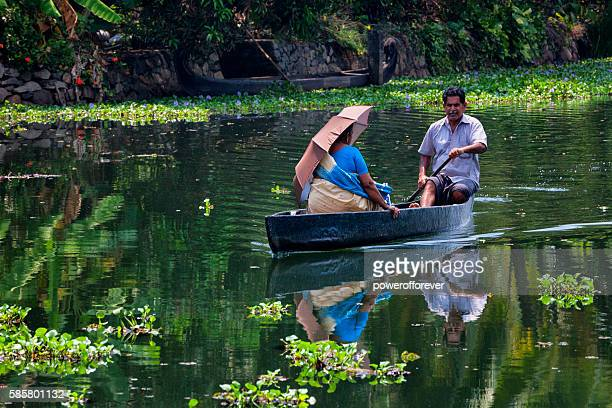 Couple traveling by Kettuvallam on the Kerala Backwaters, India