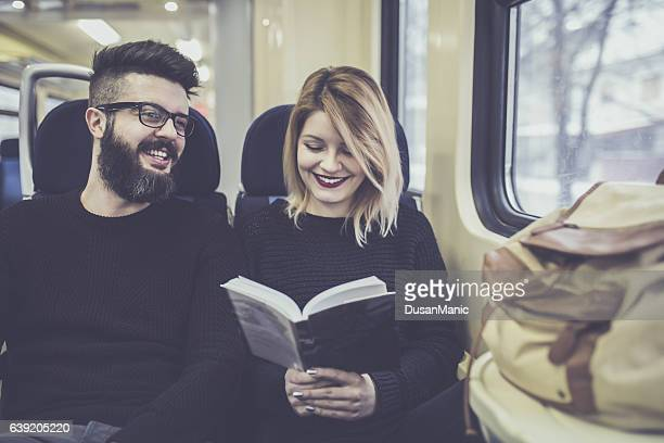 Couple traveling by train