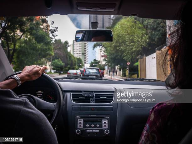 couple traveling in car - vehicle interior stock pictures, royalty-free photos & images