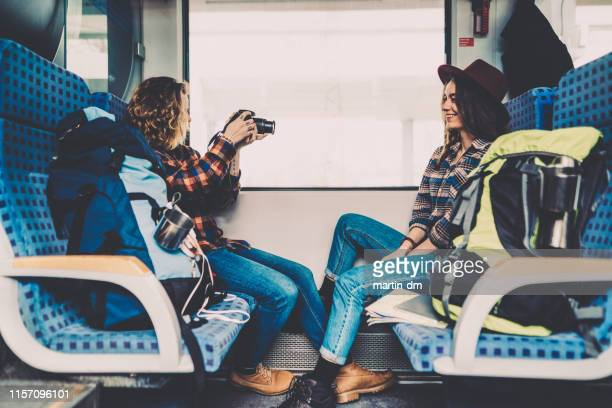 couple traveling in train and vlogging - passenger train stock pictures, royalty-free photos & images