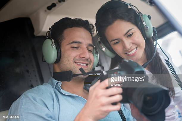 Couple traveling on a helicopter