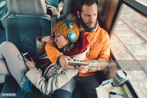 couple traveling with train - train stock photos and pictures