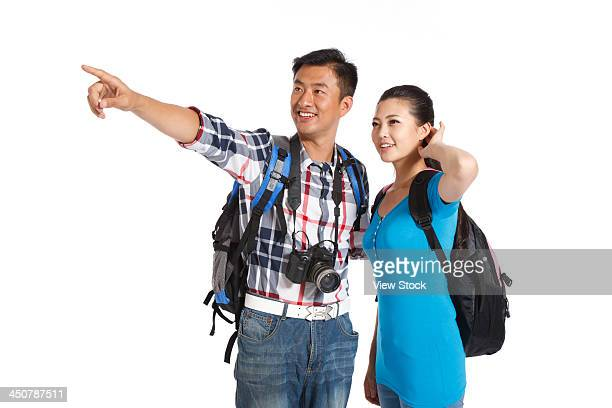 Couple travelling and carrying camera
