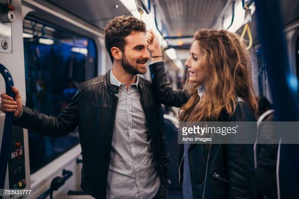 couple travelling in train, florence, italy - cable car stock pictures, royalty-free photos & images