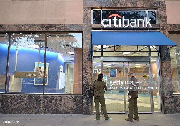 A couple try to enter a Citibank branch on October 5 2016 in Washington DC Wall Street stocks gained led by petroleum companies due to higher oil...