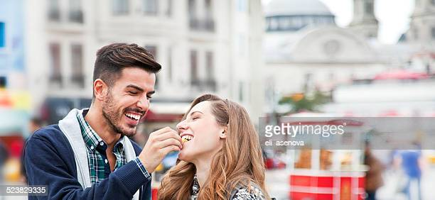 couple trying chestnuts in istanbul. - chestnut food stock pictures, royalty-free photos & images