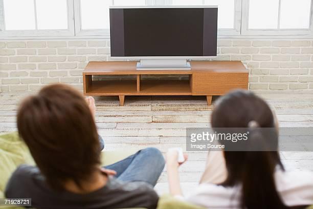 Couple turning television on