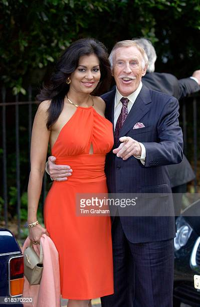 Couple TV personality Bruce Forsythe with his wife Wilnelia attend a celebrity party hosted by broadcaster Sir David Frost in Chelsea