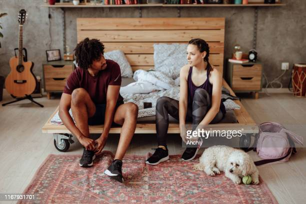 couple tying shoes - women trying on shoes stock pictures, royalty-free photos & images