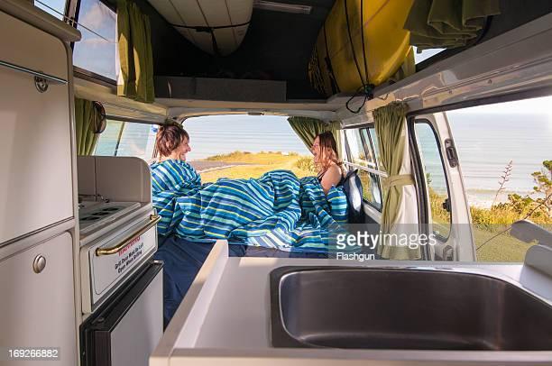 Couple under comforter in trailer