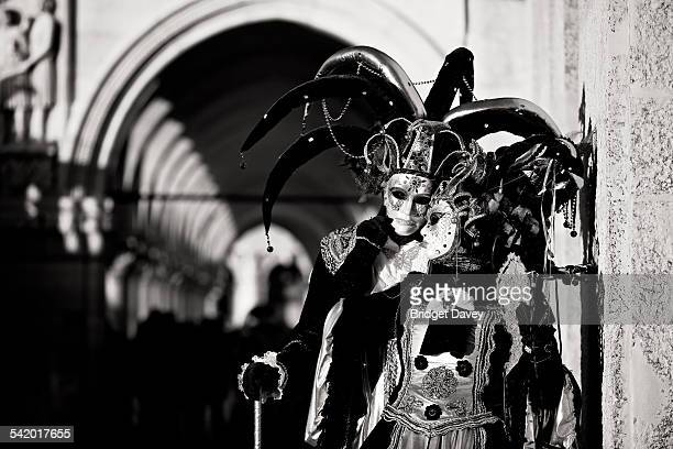 Couple under Doge Palace Venice Carnival Carnival di Venezia in Venice Italy Annual festival in Venice ends with celebration of Lent 40 days before...