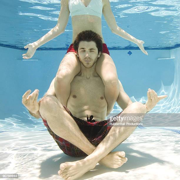 couple underwater - carrying a person on shoulders stock photos and pictures