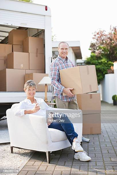 Couple unloading moving van