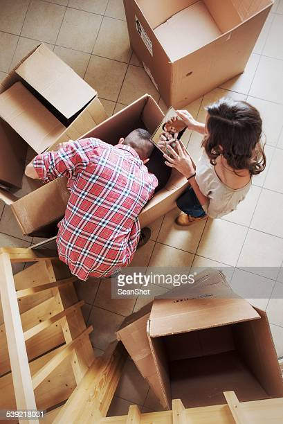Couple Unpacking Boxes During a Moving