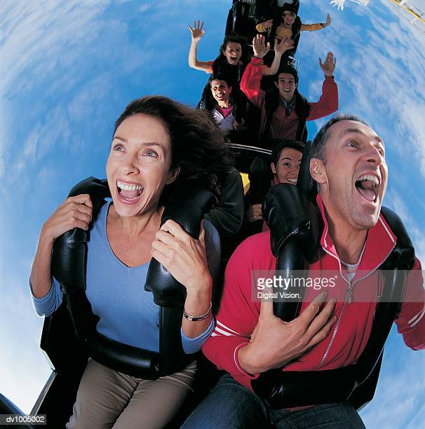 Couple upside Down on a Roller Coaster