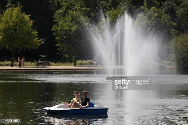 A couple use a pedalo in Victoria Park in high temperatures on July 25 2012 in London England Temperatures in the capital reached 31 degrees Celsius...