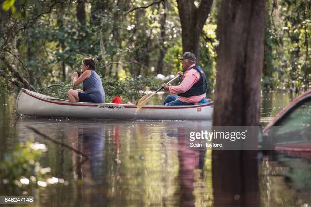 A couple uses a canoe to navigate flood waters caused by Hurricane Irma September 12 2017 in Middleburg Florida United States The storm brought...
