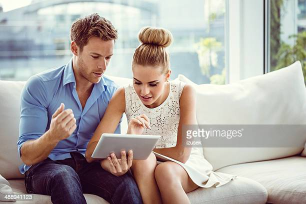 Couple using a digital tablet