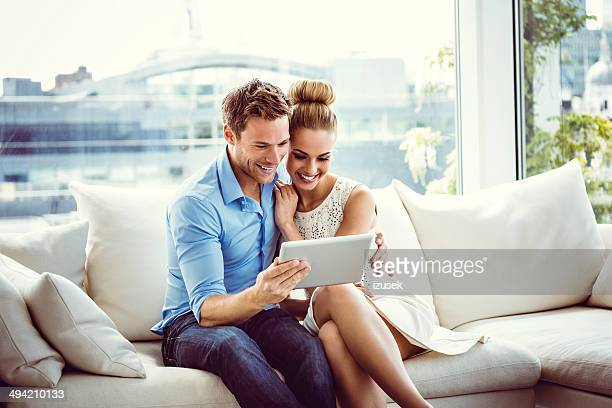 couple using a digital tablet - stereotypically upper class stock pictures, royalty-free photos & images