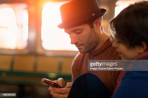 Couple using cell phone together