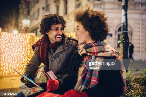 Couple using credit card and digital tablet