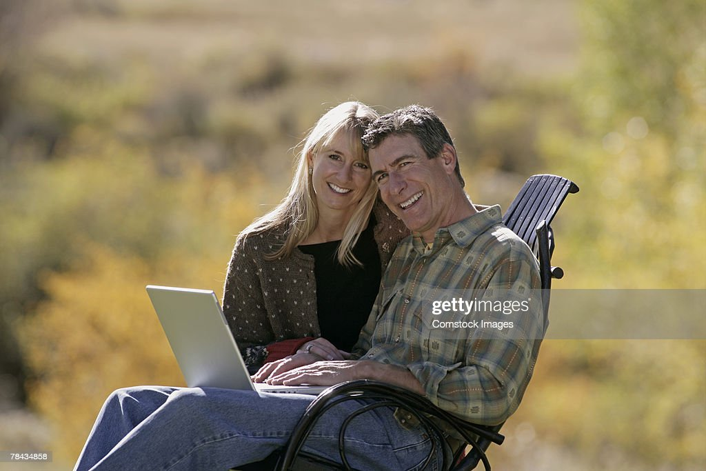 Couple using laptop : Stock Photo