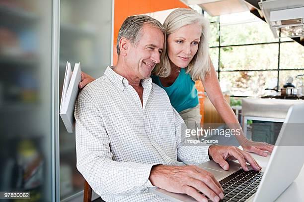 Couple using laptop