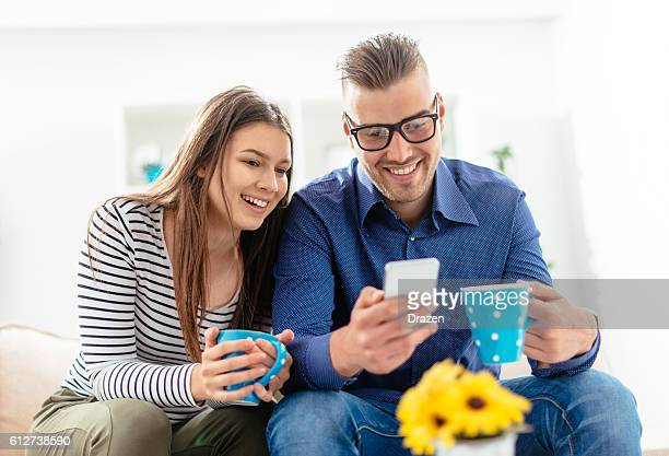 Couple using phone for mobile gaming