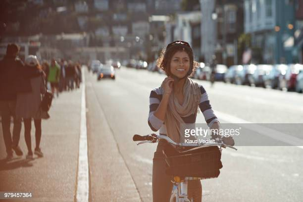 couple using rental bikes in the small town sausalito - sportschutzhelm stock-fotos und bilder