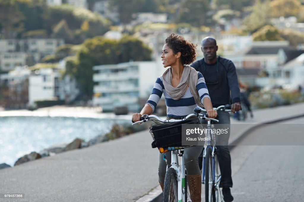 Couple using rental bikes in the small town Sausalito : Stock Photo
