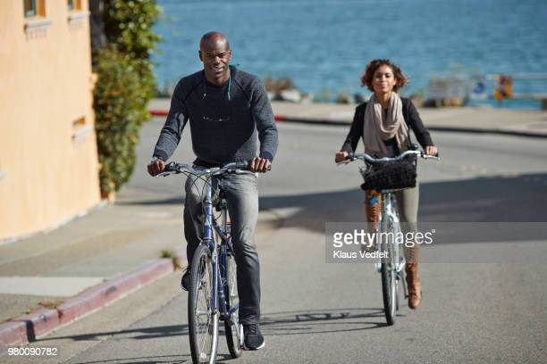 Couple using rental bikes in the small town Sausalito