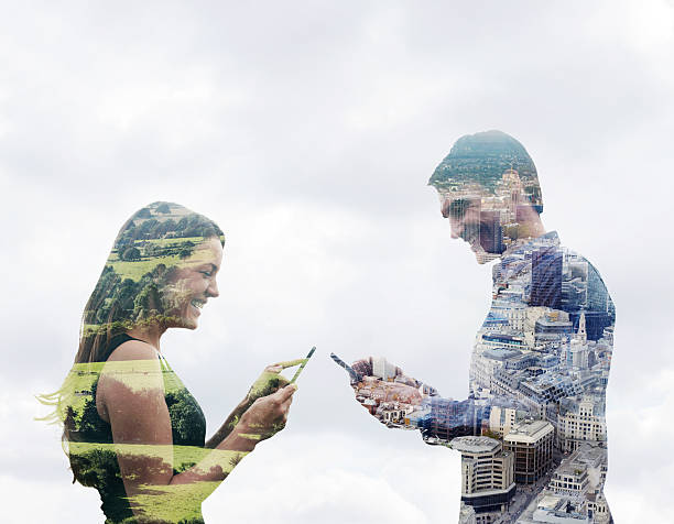 Couple Using Smart Phones In Different Locations. Wall Art
