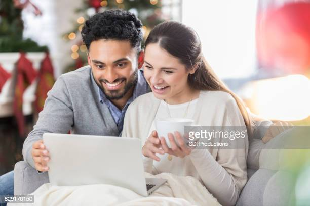 Couple video chat with family on Christmas Day
