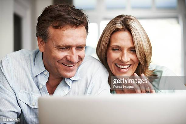 Couple video conferencing on laptop